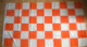 Tangerine and White Checkered Large Flag - 5' x 3'.